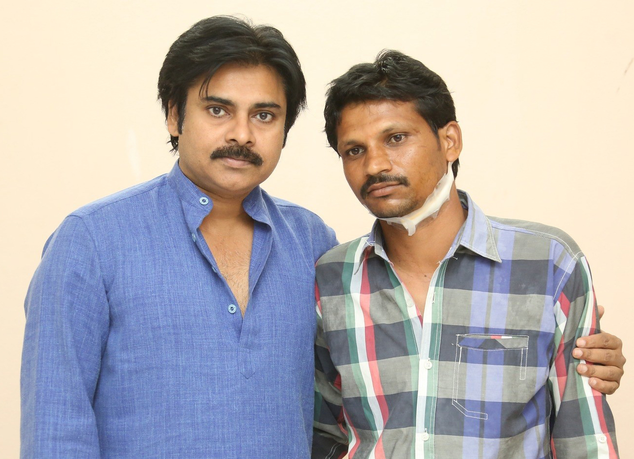 Pawan Kalyan with Injured fan Srinivas