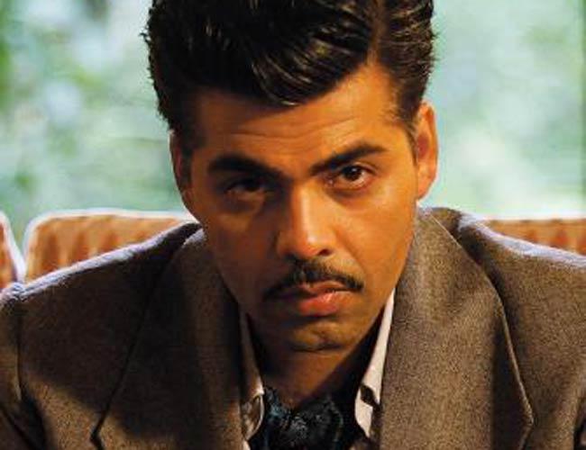 Karan Johar as Kaizad Khambatta