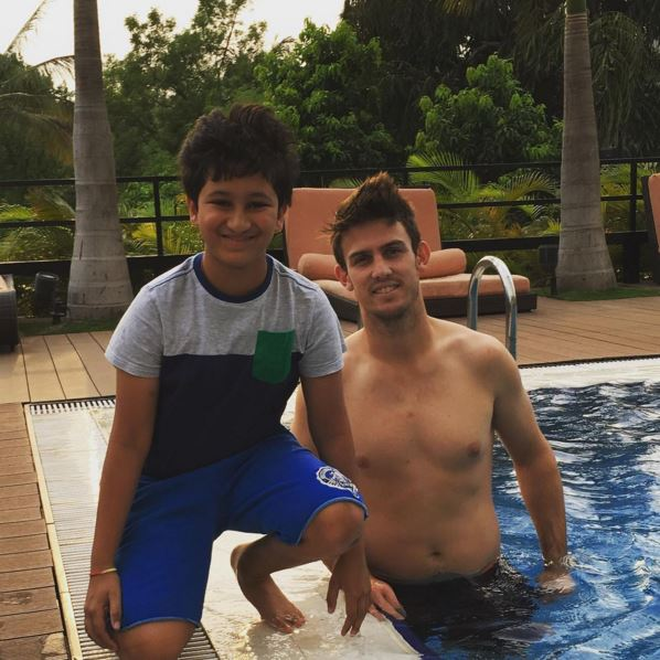 Gautam with Mitchell Marsh